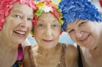 Women Wearing Colorful Bathing Caps