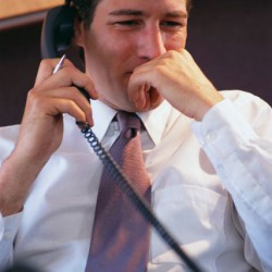 Businessman Listening on Telephone